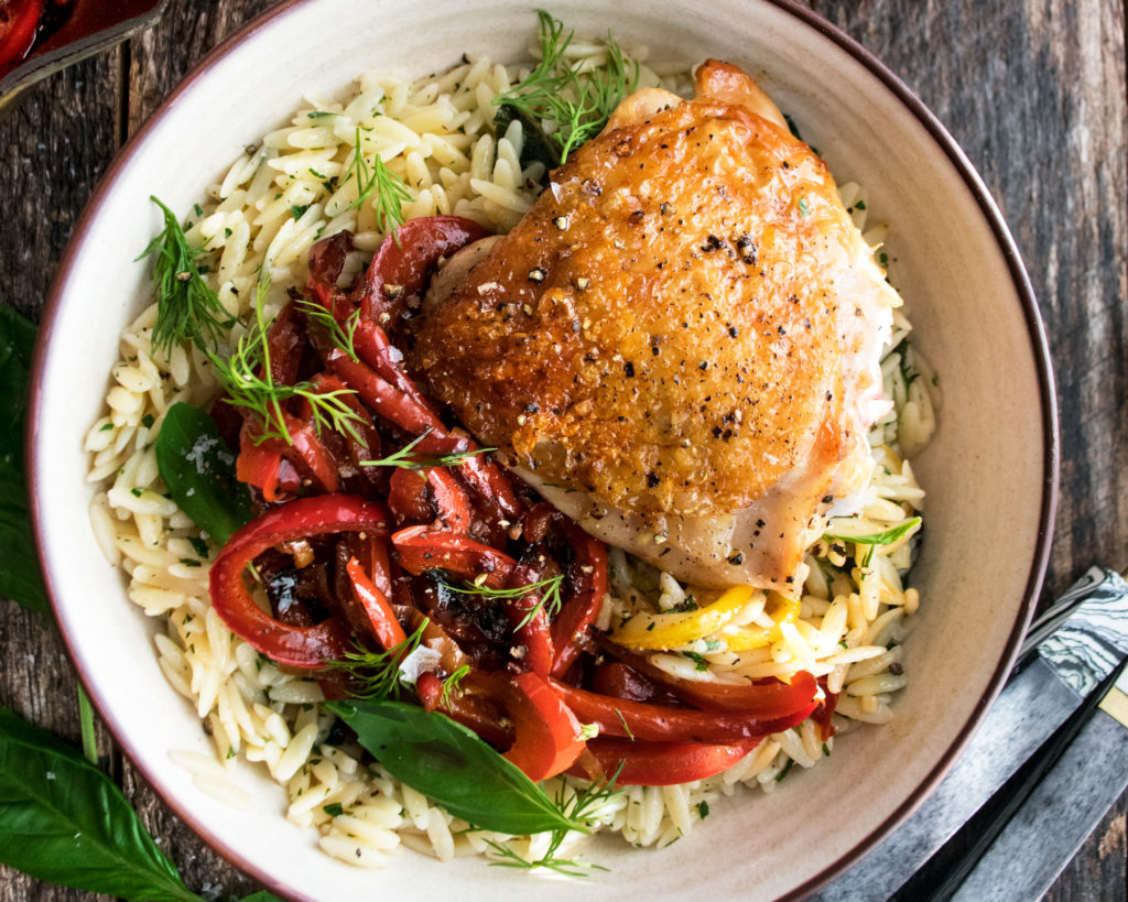Crispy Chicken Thighs with Herb Orzo & Stewed Peppers